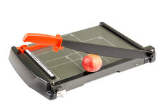 Paper trimmer with an apple under blade Stock Photos