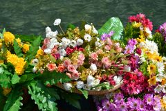 Paper tropical flowers exposed for decoration of a boat. stock images