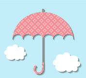 Paper umbrella with clouds Stock Images