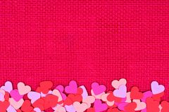Paper Valentines Day hearts bottom border on pink burlap Royalty Free Stock Photography