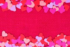 Paper Valentines Day hearts double border on pink burlap Royalty Free Stock Images