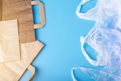 Paper vs plastic bags for packaging and carrying products. Choose for protection of the environment. Place for text. Eco paper vs plastic bags for packaging and royalty free stock images