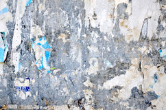 Paper on the wall. Dirty old paper on the wall close up photo Stock Photography