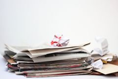 Paper waste on white background. Paper waste: stack of old newspapers and pieces of cardbord and paper on white background stock photo