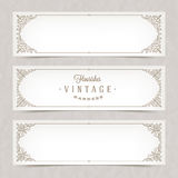 Paper white banners with flourishes frames Stock Photo