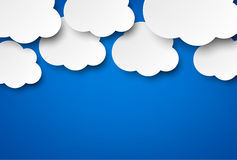 Paper white clouds on blue. Vector abstract background composed of white paper clouds over blue. Eps10 Royalty Free Illustration