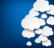 Paper white clouds on blue. Vector abstract background composed of white paper clouds over blue. Eps10 Stock Illustration