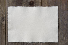 Paper - white, handmade. On the old wood fence Royalty Free Stock Photos