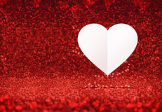 Paper white heart floating at red sparkling glitter room backgro Royalty Free Stock Photo