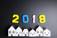 Paper white house toy and number 2018 on black background with c Stock Photography