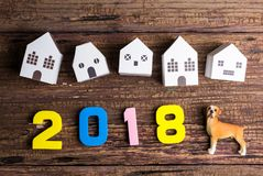 Paper white house toy and number 2018 on wooden background with Royalty Free Stock Image