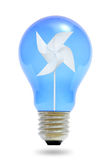 Paper windmill in a blue light bulb. Stock Photos