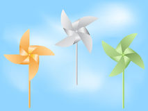 Paper windmill in blue sky Stock Photo