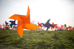 Paper windmill. Colorful paper windmill on green grass stock photography