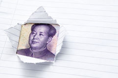 Paper with window opening showing Chinese currency Stock Photo