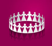 Paper women holding hands in the shape of a circle. Royalty Free Stock Photography