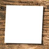Paper on wood. White paper on ancient wood with drop shadow Royalty Free Stock Image