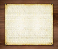 Paper on a Wood Background Royalty Free Stock Photography