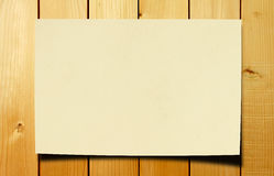 Paper on wood table Royalty Free Stock Image