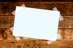 Paper on wood wall Royalty Free Stock Photos