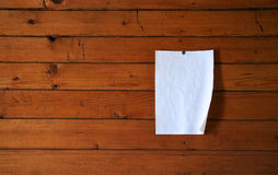Paper on wood wall Stock Photo