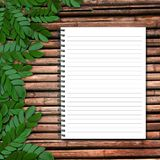 Paper on wooden background Royalty Free Stock Photography