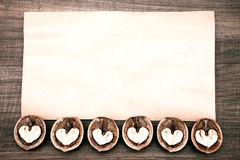 Paper on wooden background with abstract hearts Stock Photo