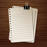 Paper on a wooden background. Note vector  background Royalty Free Stock Photo