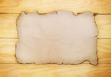 Paper on wooden boards Stock Photography