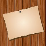 Paper on a wooden wall Stock Photos