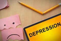 Paper with word depression and broken pencil Stock Images