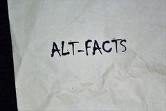 Paper with the Words Alt-Facts. This image shows a paper containing the words Alt-Facts, the controversial term used by Kellyanne Conway, Counselor to U.S stock images