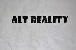 Paper with the Words `Alt Reality``. This image shows a paper containing the words `Alt Reality,` suggesting the term `alt-facts` used by Kellyanne Conway stock photo