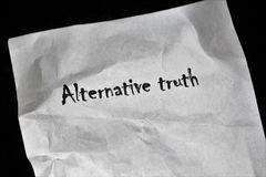 """Paper with the Words Alternative Truth. This image shows a paper containing the words Alternative truth,` suggestive of the term """"alt facts"""" cited by royalty free stock image"""