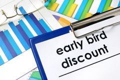 Paper with words Early bird discount. Paper with words Early bird discount and charts Stock Image