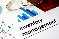 Paper with words inventory management. Paper with words inventory management and charts Royalty Free Stock Images
