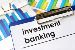 Paper with words investment banking. Paper with words investment banking and charts Royalty Free Stock Photos