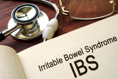 Paper with words Irritable bowel syndrome (IBS). And glasses royalty free stock photos