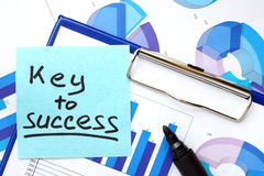 Paper with words Key To Success and graphs. Royalty Free Stock Photo