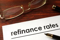 Paper with words refinance rates. Royalty Free Stock Photography