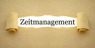 Paper work with the german word for time management - zeitmanagement. Brown Paper work with the german word for time management - zeitmanagement royalty free stock photos