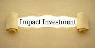 Paper work with impact investment stock image