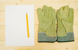 Paper with the working tool on wooden background Stock Images