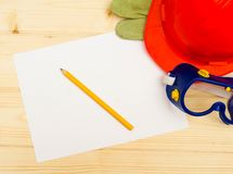 Paper with the working tool on wooden background Royalty Free Stock Photos