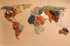 Paper with world map made. Of different aromatic spices as background, top view stock photo