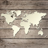 Paper world map on a wooden board vector Stock Images