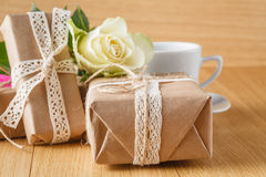 Paper wrapped gift box with white rose Stock Image