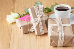 Paper wrapped gift box with white rose Stock Photography