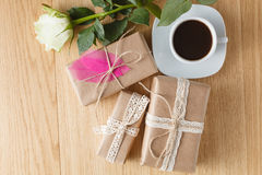 Paper wrapped gift box with white rose Royalty Free Stock Photos