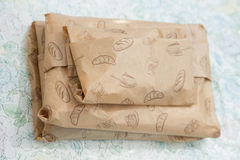 Paper wrapped packages with cake, bread, flour, biscuit, pastries ornament Stock Photos